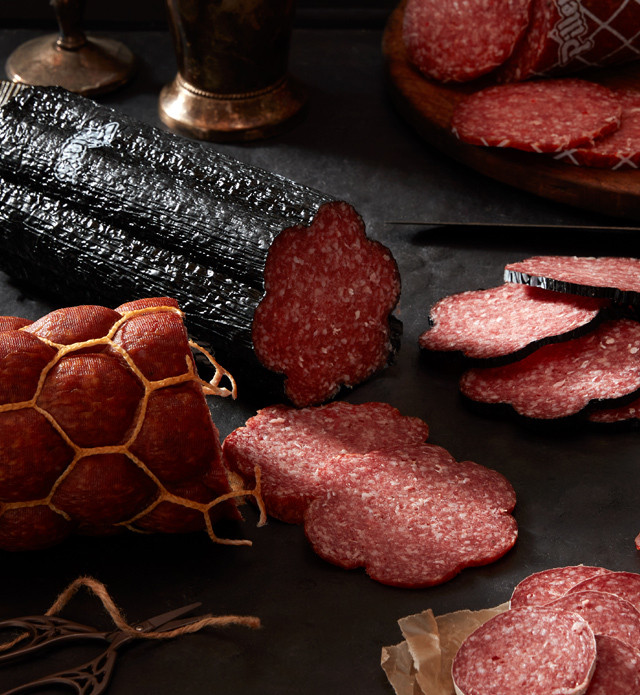 Close up of different kinds of salami.
