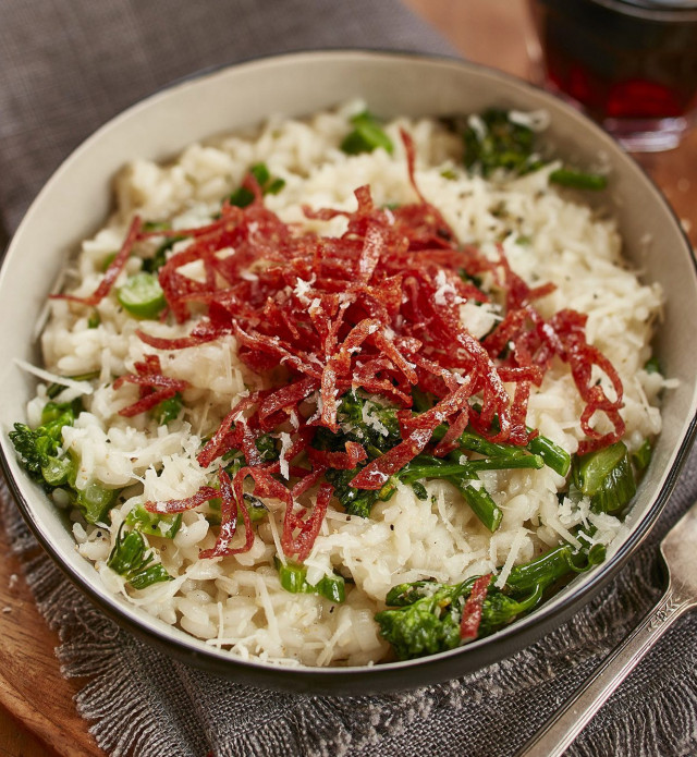 Risotto with salami in a white bowl